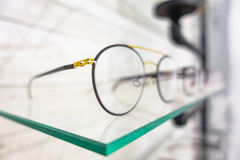 Glasses closeup in exhibitor. Macro of glasses corner closeup in exhibitor Stock Photos