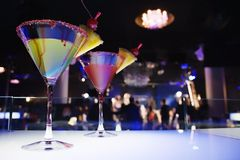 Glasses with cocktail. In nightclub, different kinds of lighting Royalty Free Stock Photo
