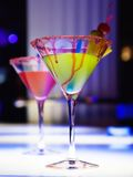 Glasses with cocktail. In nightclub, different kinds of lighting Stock Image