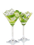 Glasses of cocktail with lime and mint Royalty Free Stock Photos