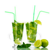 Glasses of cocktail with lime and mint Stock Photography