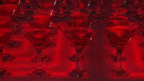 Glasses with cocktails.In. A multi-colored background stock video footage