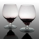 Glasses of cognac. Two glasses from colors glass close up Stock Image
