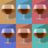 Glasses of cognac set on metal stand Royalty Free Stock Image