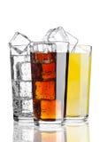 Glasses of cola orange soda lemonade with ice Stock Images