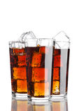 Glasses of cola soda drink cold with ice cubes Stock Images