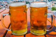 Glasses of cold beer. Big glasses of cold beer on table Royalty Free Stock Photo