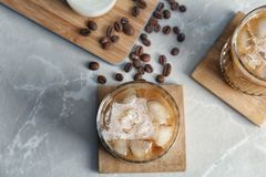 Glasses with cold brew coffee and milk. On light background stock photo