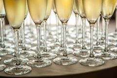 Glasses with cold champagne at the event stock images