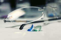 Glasses and colored contact lenses. Close up stock photos