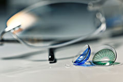 Glasses and colored contact lenses. Close up royalty free stock images