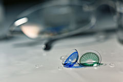 Glasses and colored contact lenses Stock Image