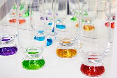 Glasses of colored glass. On white Royalty Free Stock Image