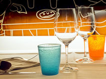 Glasses and colored glasses in  bistro for a romantic date. Glasses and colored glasses in a bistro for a romantic date Stock Image
