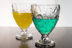 Glasses of colored juice Stock Images