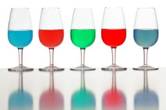 Glasses of colored liquid. Photographed on a white background Royalty Free Stock Photography