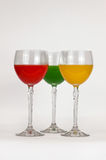 Glasses with colored water. Three glasses with multi-colored water Royalty Free Stock Photo