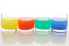 Glasses with colorful liquid Royalty Free Stock Photos