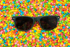 Glasses on colorful mini chewing gum Royalty Free Stock Photography