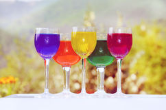 Glasses with colorful wine Royalty Free Stock Images