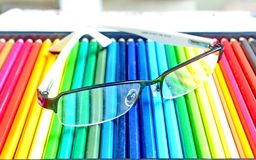 Glasses and  colors pencil Stock Image