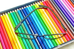 Glasses and  colors pencil Royalty Free Stock Photos