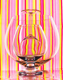 Glasses on colourful striped background Stock Photography