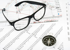 Glasses and compass Stock Images