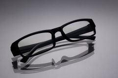 Glasses for a computer in a black frame closeup on a gray surfac Stock Photo