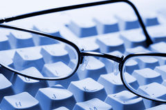 Glasses on Computer Keyboard Royalty Free Stock Photo