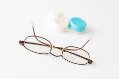 Glasses and contact eye lenses. Case on white background Royalty Free Stock Images