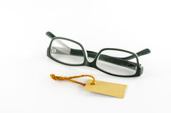 Glasses and cost tag Royalty Free Stock Photo