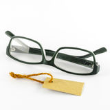 Glasses and cost tag Royalty Free Stock Photos