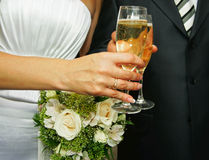 Glasses at a couple. Glasses with a champagne at a newly-married couple Royalty Free Stock Photo
