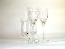 Glasses on creamy background. Tranparent wine glasses on light creamy background royalty free stock photo