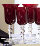 Glasses of crystal. Set of glasses of crystal of red color Stock Photo