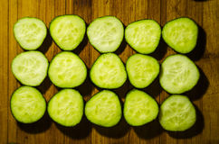 Glasses of cucumber cocktail on cutting board on wooden backgrou Stock Photos