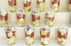 Glasses with cut fruits Stock Photos
