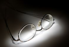Glasses in the dark Stock Images