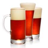 Glasses of dark beer on white Stock Image