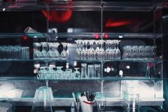 Glasses decoration stand in a bar by mirror stock photo