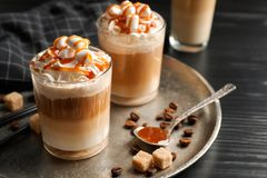 Glasses with delicious caramel frappe. On tray Stock Images