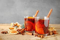 Glasses of delicious Christmas mulled wine on sackcloth Royalty Free Stock Photo