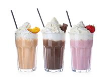 Glasses with delicious milk shakes. On white background stock images