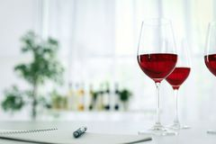 Glasses with delicious wine on table Royalty Free Stock Photography