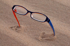 Glasses in desert Royalty Free Stock Photos