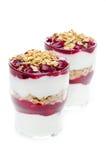 Glasses with dessert of yogurt, granola, cherry Royalty Free Stock Image