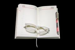 Glasses on diary Stock Photo