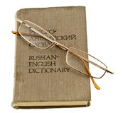 Glasses and dictionary Stock Images
