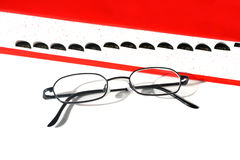 Glasses and Dictionary. Eye Glasses and a dictionary on white background Stock Photo